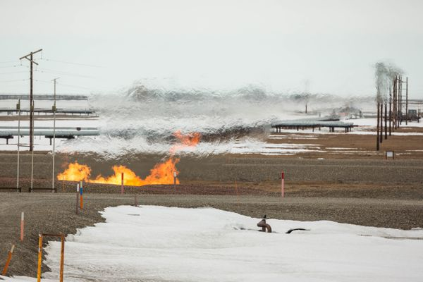A gas flare burns near Prudhoe Bay's Lisburne Production Center on Friday, May 22, 2015. (Loren Holmes / Alaska Dispatch News)