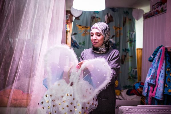 Fatiha looks at a dress that she bought for a granddaughter at her home in Ranst, Belgium, on Wednesday, Feb. 13, 2019. MUST CREDIT: Photo for The Washington Post by Virginie Nguyen Hoang.