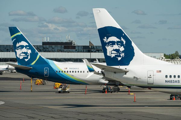 Two Alaska Airlines planes are parked at the Ted Stevens Anchorage International Airport on Friday, June 5, 2020. (Loren Holmes / ADN)