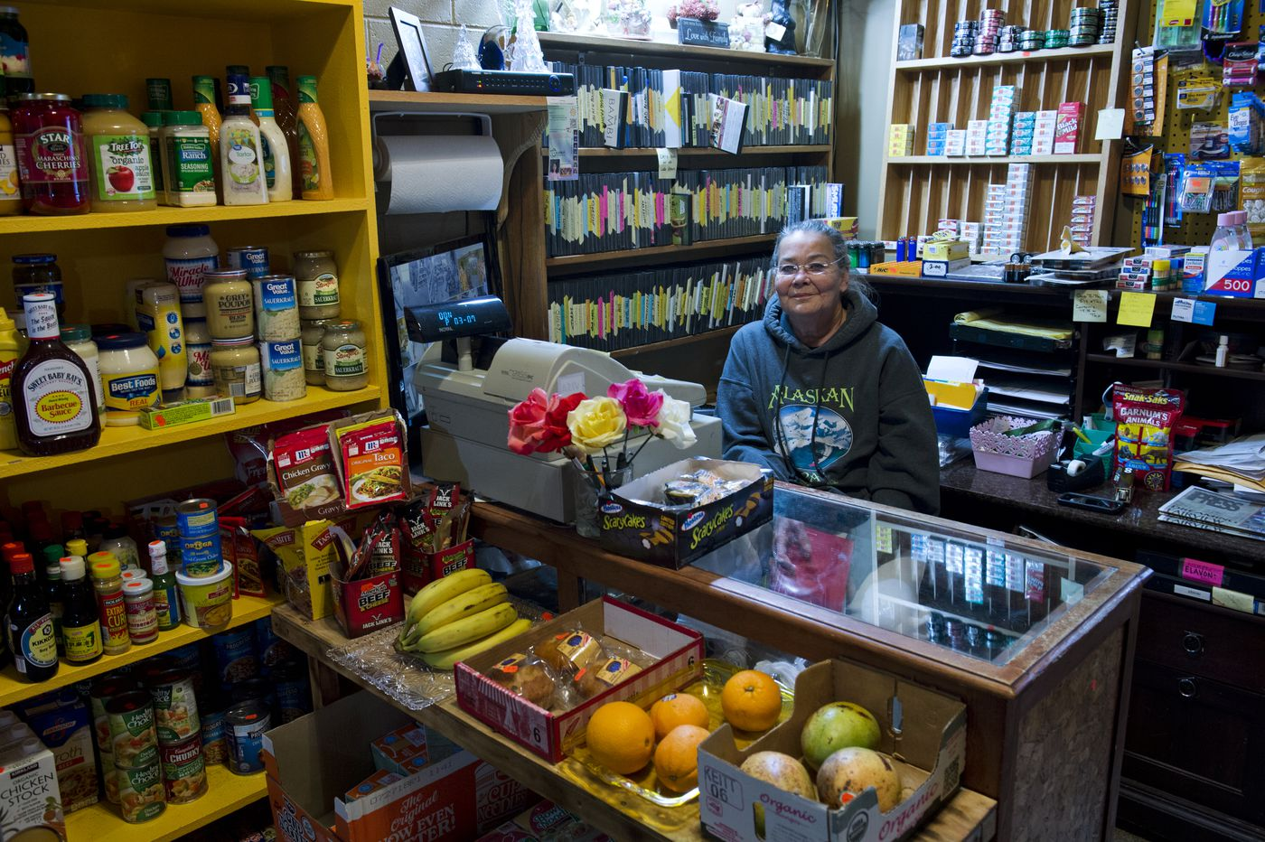 Vicki Dibble works the counter at the Kozy Korner store inside Begich Towers on Oct. 10. The building, consisting of 196 condos, is home to most of Whittier's residents. (Marc Lester / Alaska Dispatch News)