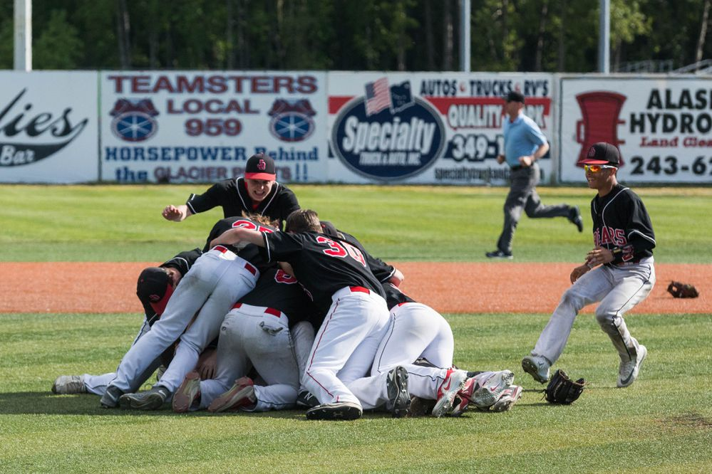 The Juneau-Douglas Crimson Bears celebrate their win over South Anchorage during the state high school baseball championship game Saturday, June 2, 2018 at Mulcahy Stadium. (Loren Holmes / ADN)