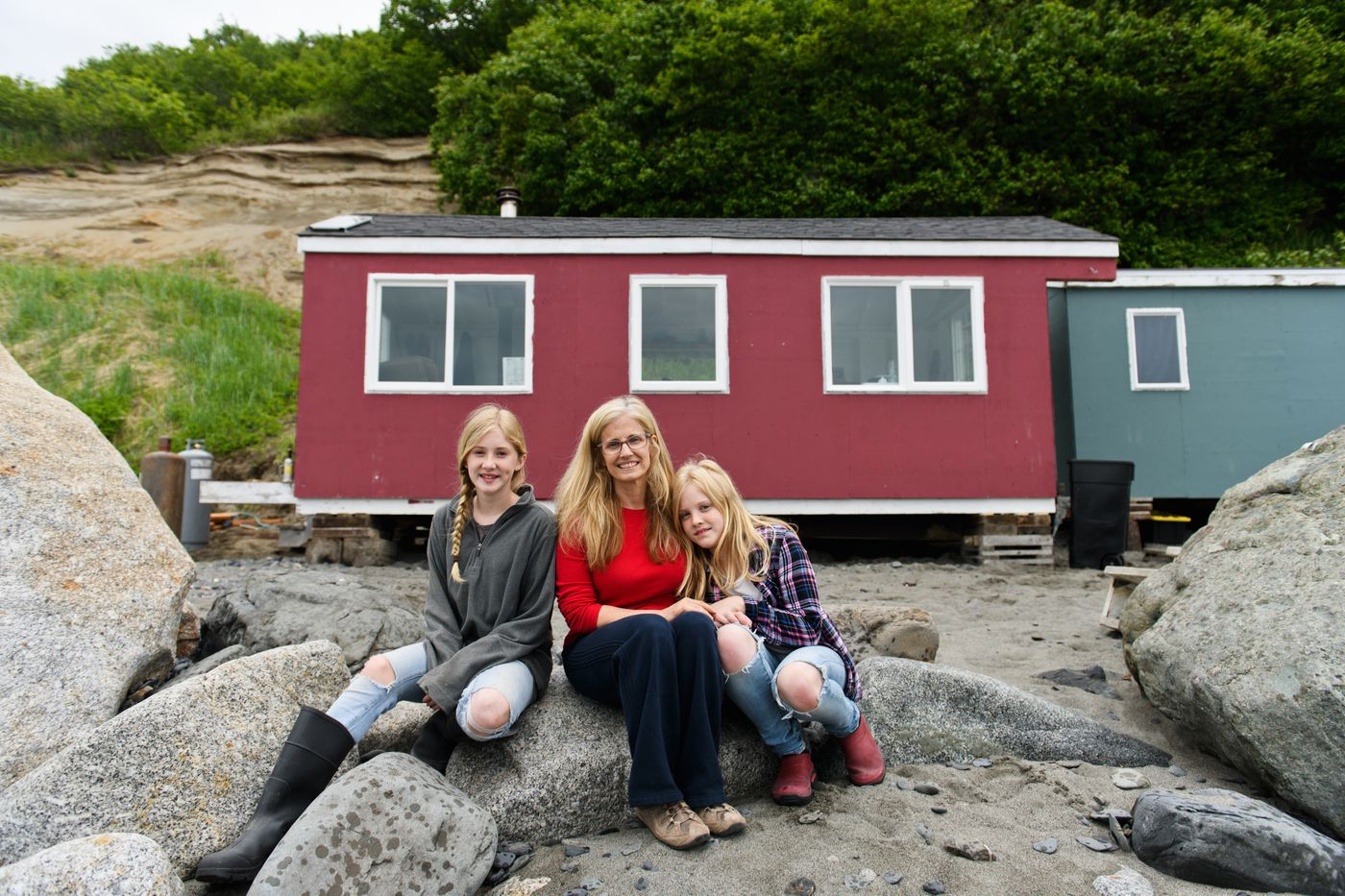 Rita Clucas and her daughters set up their family's setnet fishing camp on the beach at Clam Gulch on June 21, 2018. Thirteen-year-old Samara is at left, and Avielle, 11, is at right. (Marc Lester / ADN)