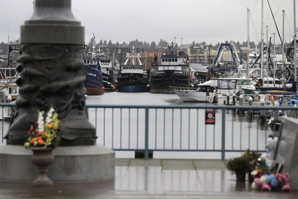 Fishing and boats used for other purposes are shown parked near the Seattle Fishermen's Memorial, Thursday, Jan. 2, 2020, in Seattle. Items left at the memorial Thursday included a ball cap with the name of the crab fishing boat Scandies Rose, a 130-foot crab fishing boat from Dutch Harbor, Alaska, that sank on New Year's Eve. (AP Photo/Ted S. Warren)