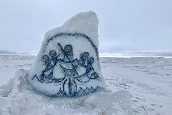 An artist made this whaling scene on a piece of ice near Utqiagvik where whaling crews are busy hunting through May. Photographed May 11, 2021. (Kyle Hopkins / ADN)