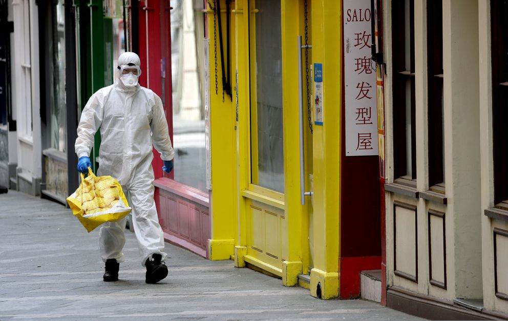 A man wears full protective equipment to protect against the coronavirus as he shops in London, Monday, May 4, 2020, as the UK enters a seventh week of lockdown to help stop the spread of coronavirus. The highly contagious COVID-19 has impacted on nations around the globe, many imposing self isolation and exercising social distancing when people move from their homes. (AP Photo/Kirsty Wigglesworth)