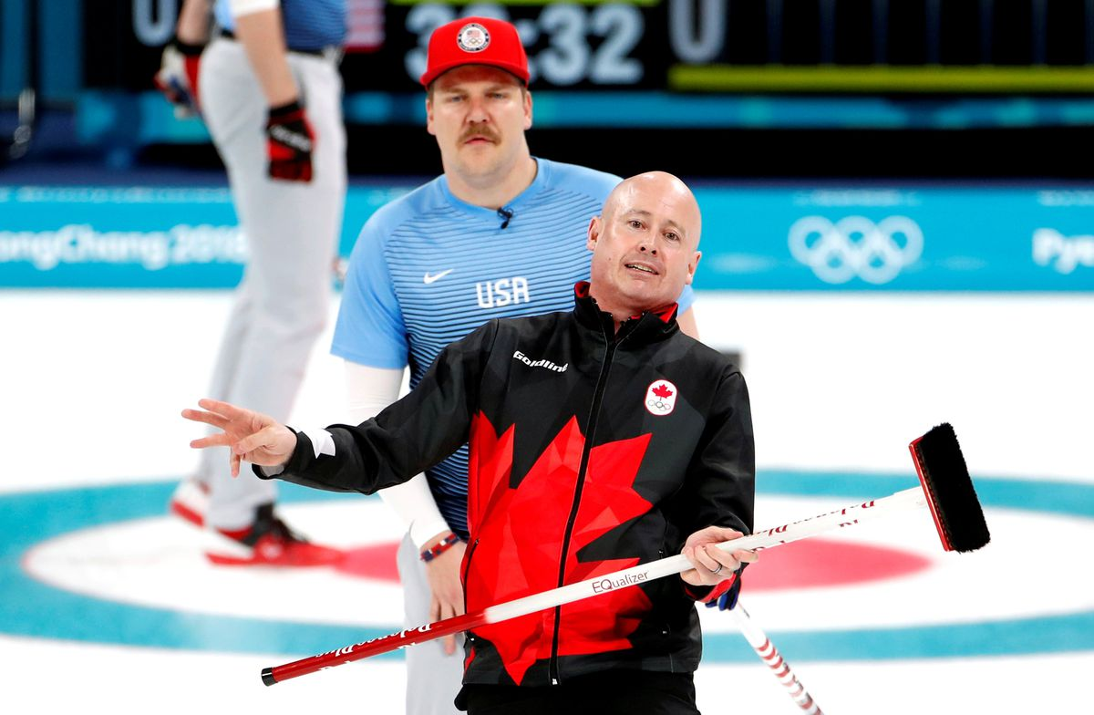 Skip Kevin Koe of Canada reacts as second Matt Hamilton of the U.S. looks on. REUTERS/Cathal McNaughton
