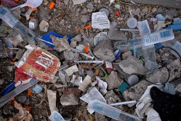 Needles used for shooting heroin and other opioids along with other paraphernalia litter the ground in a park in the Kensington section of Philadelphia, Pennsylvania, on October 26, 2017. (Charles Mostoller / Reuters file)