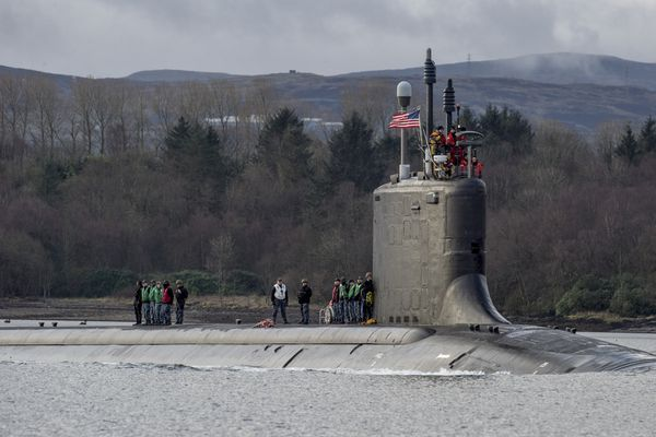 The USS Virginia, a Navy attack submarine, glides along Gare Loch, near Glasgow, Scotland, towards Her Majesty's Naval Base Clyde, a Royal Navy base, March 22, 2016. Russian attack submarines, the most in two decades, are prowling the coastlines of Scandinavia and Scotland, the Mediterranean Sea and the North Atlantic in what Western military officials say is a significantly increased presence.