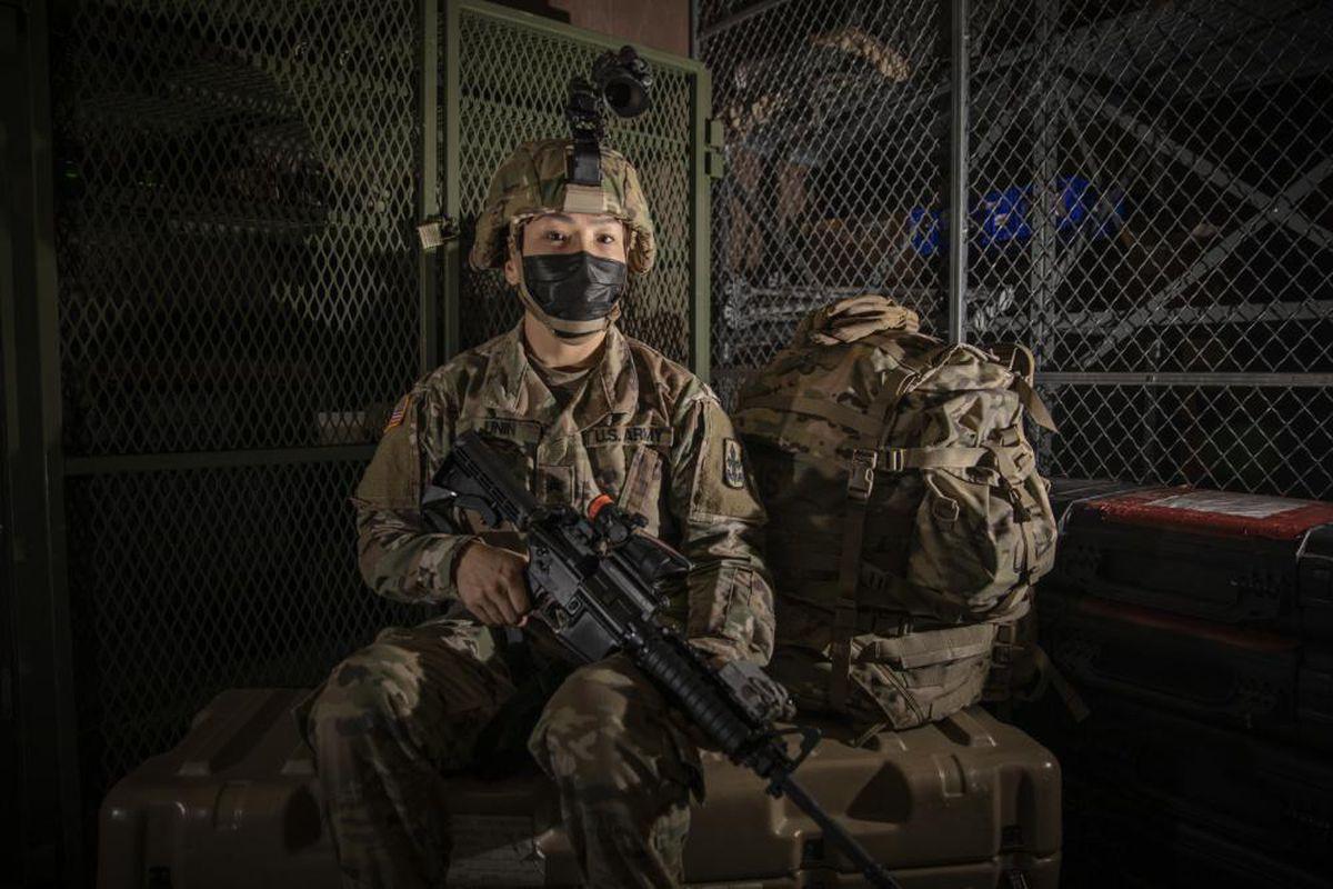 Sgt. Serita Unin, a fireteam leader with Bison Company, 1st Battalion, 297th Infantry Regiment, Alaska Army National Guard, on Joint Base Elmendorf-Richardson. (Edward Eagerton / Alaska National Guard Public Affairs via KYUK)
