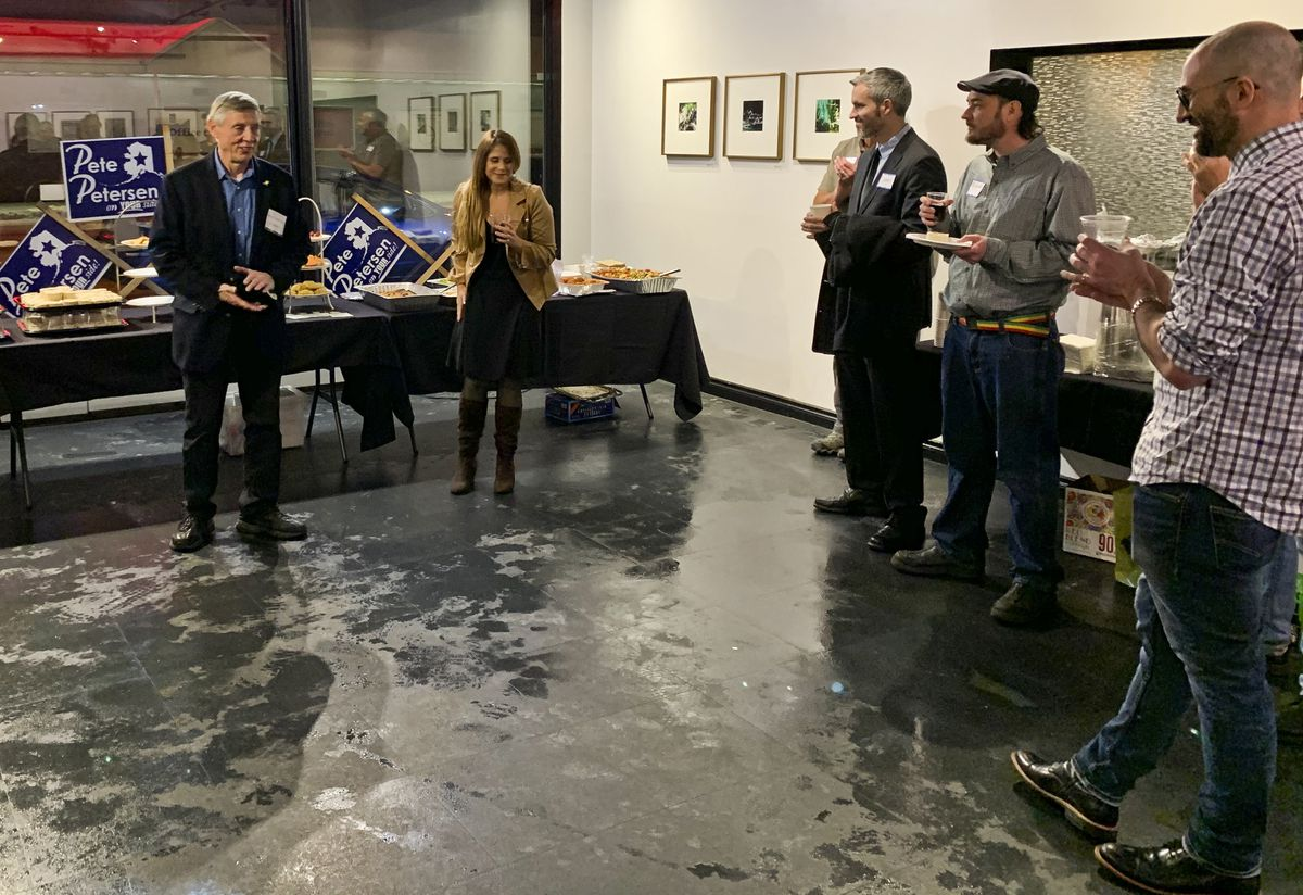 Assemblyman Pete Petersen (left) and Jana Weltzin (right) address a crowd of about 40 in the marijuana industry on Jan. 30 at a fundraising event for Petersen's reelection campaign. Weltzin, a marijuana attorney and board member for the Alaska Marijuana Industry Association, has thrown fundraisers for several Anchorage politicians and encourages her clients to be politically active. (Aubrey Wieber / Anchorage Daily News)