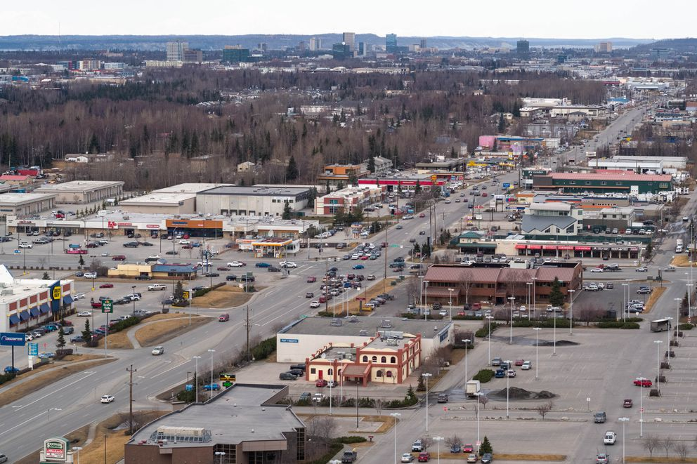 Businesses line the Old Seward Hwy at Dimond Blvd on Tuesday, April 17, 2018. (Loren Holmes / ADN)