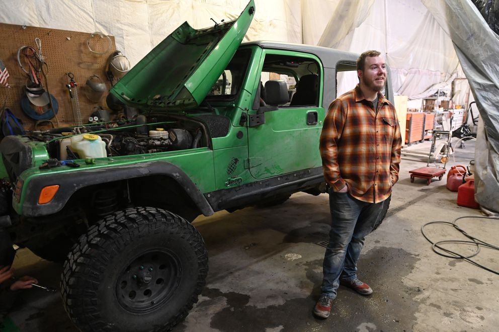 Josh Tills' Jeep broke through ice during a trip to Knik Glacier on Sunday. On Wednesday, the Jeep was thawing out at Ice Monkey Garage in South Anchorage as mechanics worked to get it running again. (Bill Roth / ADN)