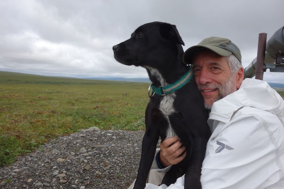 Cora the dog and Eric Troyer, who walked for a week with NedRozellon the path of the trans-Alaska pipeline. (NedRozell)