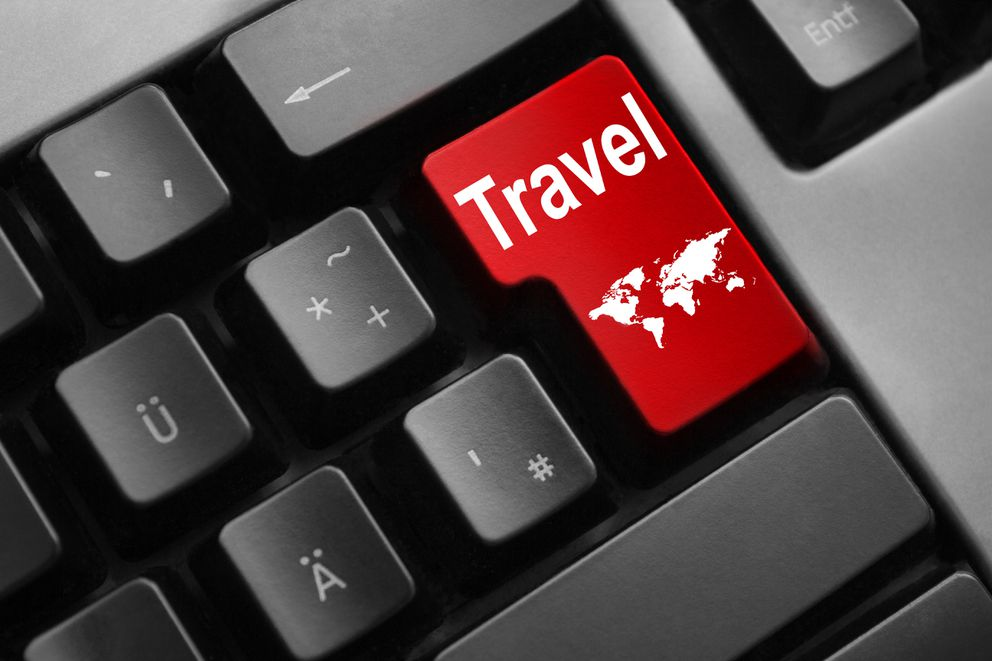 grey keyboard red enter button travel world (Getty Images)