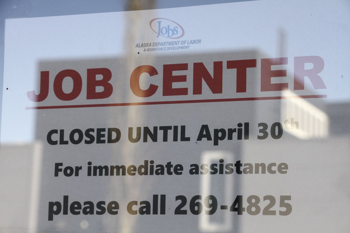 A sign saying that the Jobs Center at the Alaska Department of Labor and Workforce Development office in midtown Anchorage, Alaska, is closed through the end of April is shown Monday, March 30, 2020. (Mark Thiessen / Associated Press)