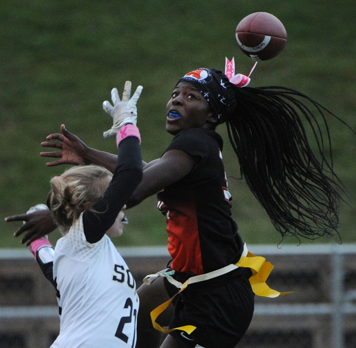 South High defender Maris Soland and West High receiver Nyeniea John battle for a ball during the Eagles' 20-12 flag football semifinal victory at South High on Thursday. (Bill Roth / ADN)