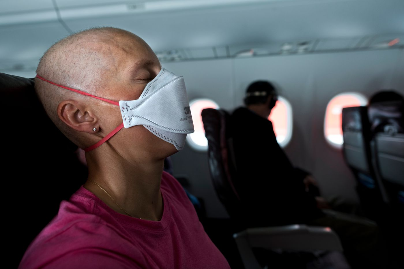 Sick with the side effects of chemotherapy, Kikkan Randall travels from Anchorage to Penticton, B.C, on Oct. 6. (Marc Lester / ADN)