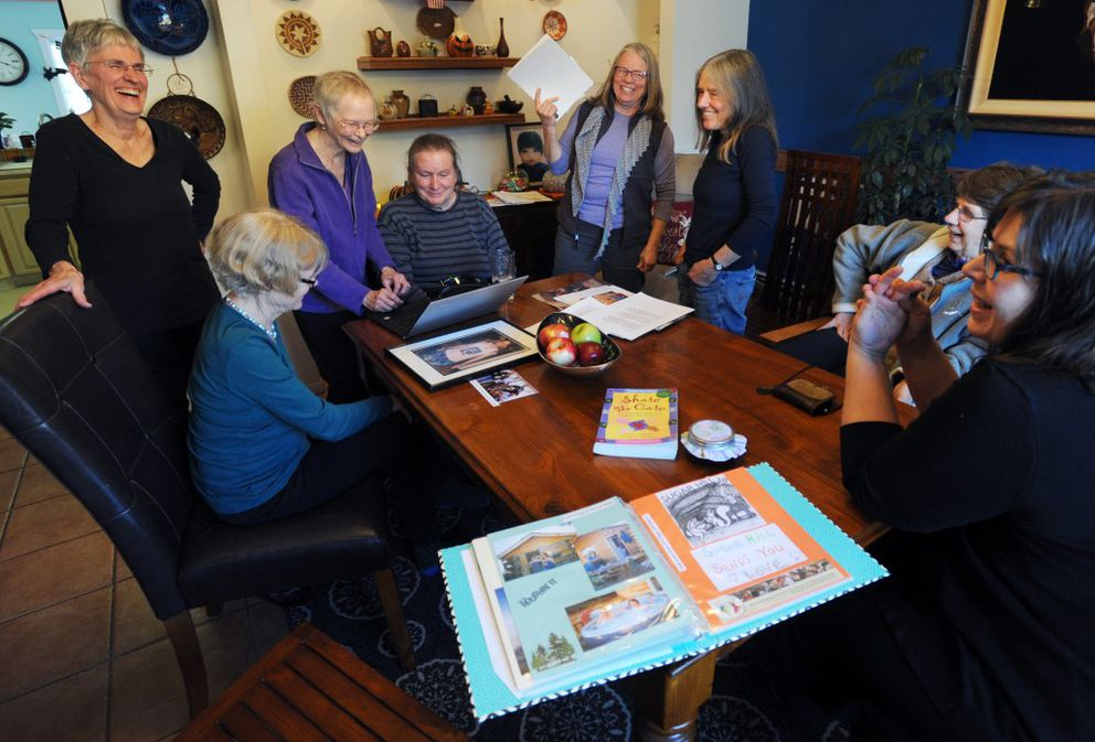 """Sherri Hadley, seated at center, isvisited by some of her """"Glacial Erratics"""" Share the Care friends on Tuesday at The Marietta House assisted living home in Anchorage. (Erik Hill / Alaska Dispatch News)"""
