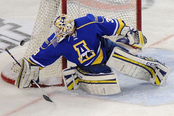 UAF goaltender Sean Cahill brushes aside a UAA shot during second-period action on Friday evening, March 6, 2015, at Sullivan Arena in Anchorage.