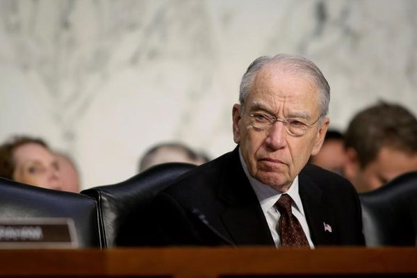 Senate Judiciary Committee Chairman Chuck Grassley (R-IA) listens as U.S. Attorney General Jeff Sessions (not pictured) testifies before a Senate Judiciary oversight hearing on the Justice Department on Capitol Hill in Washington, U.S., October 18, 2017. REUTERS/Joshua Roberts/File Photo