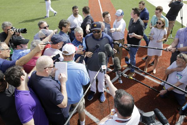 Houston Astros manager Dusty Baker is surrounded as he speaks to the media during spring training baseball practice Thursday, Feb. 13, 2020, in West Palm Beach, Fla. (AP Photo/Jeff Roberson)