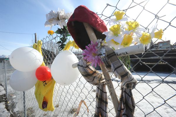 A memorial honors the woman who was killed along 3rd Avenue near Bean's Cafe and the Brother Francis Shelter when she was struck by a pickup truck on Friday. (Bill Roth / ADN)