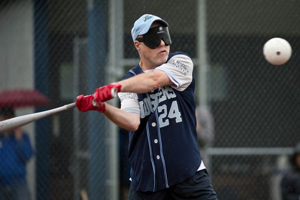 Mike King of the Sluggers takes a swing. The Seattle South King Sluggers beep baseball team took on the Chugiak Eagle River Chinooks of the Alaska Baseball League on July 18, 2017, at Loretta French Sports Complex. (Marc Lester / Alaska Dispatch News)