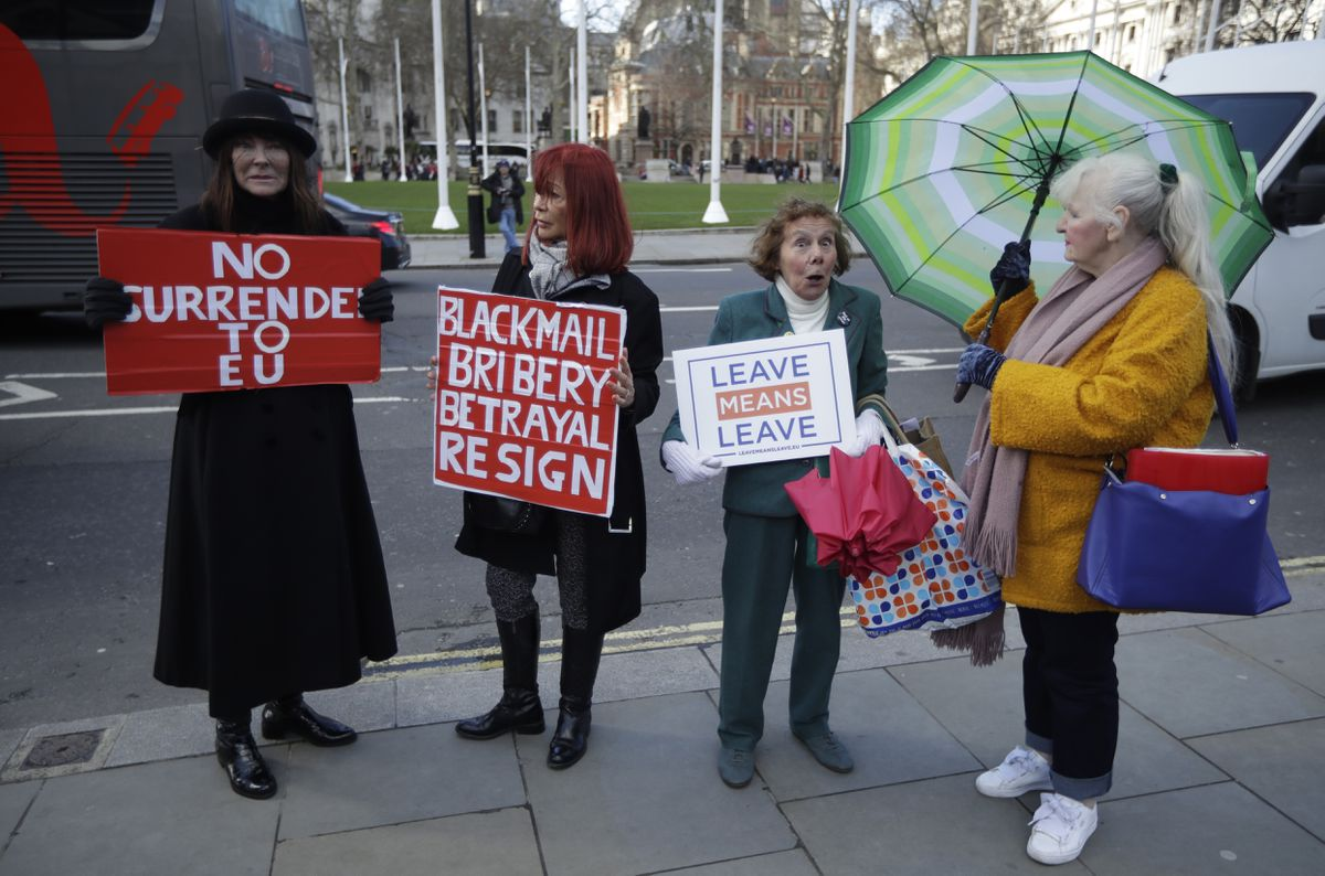 Pro-Brexit leave the European Union supporters take part in a protest outside the Houses of Parliament in London, Thursday, March 14, 2019.(AP Photo/Matt Dunham)