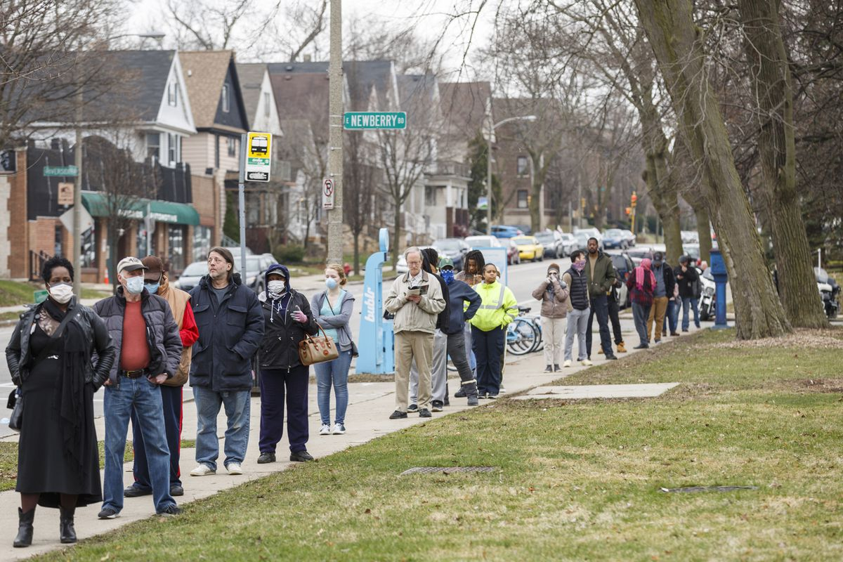 A line to vote in Wisconsin's spring primary election wraps around blocks Tuesday, April 7, 2020, in Milwaukee. (Photo for The Washington Post by Sara Stathas)