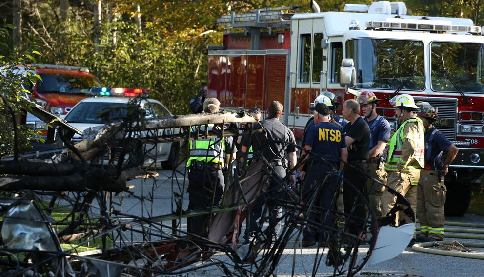 Police, fire crews and NTSB respond to the site of a plane crash on Crooked Tree Drive, in the Hillside neighborhood of Anchorage. The pilot of the plane died in the crash. (Loren Holmes / Alaska Dispatch News)