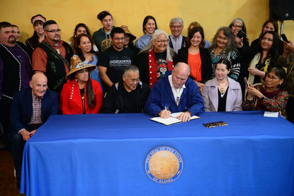Gov. Bill Walker signs AO 300 at the First Alaskans Institute's Social Justice Summit in Juneau on Sunday, Sept. 23, 2018. (Photo courtesy Office of the Governor)