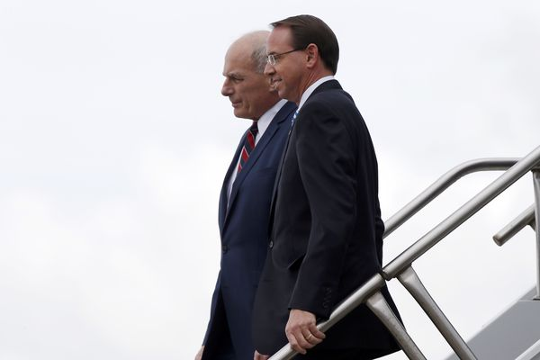 White House Chief of Staff John Kelly and Deputy Attorney General Rod Rosenstein step off Air Force One, Monday, Oct. 8, 2018, in Orlando, Fla. President Donald Trump said Monday he has no plans to fire Deputy Attorney General Rod Rosenstein, delivering a reprieve for the Justice Department official whose future has been the source of intense speculation for two weeks. (AP Photo/Alex Brandon)