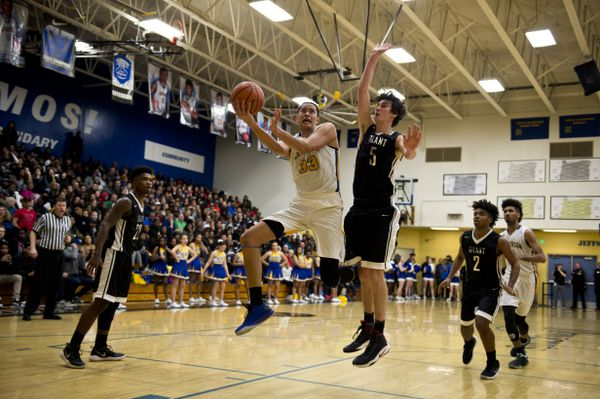 Jefferson High's Kamaka Hepa drives toward the basket in a rivalry game against Grant High School in front of a full house onFeb. 16, 2018, in Portland. (Marc Lester / ADN)