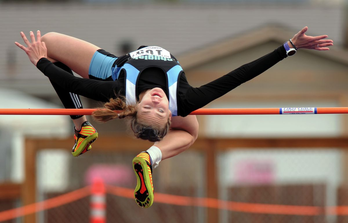 Emma Nelson of Chugiak nearly clears 5 feet, 6 inches before settling for the win at 5-4 Friday in the Cook Inlet Conference track and field championships at Dimond High. (Erik Hill / Alaska Dispatch News)