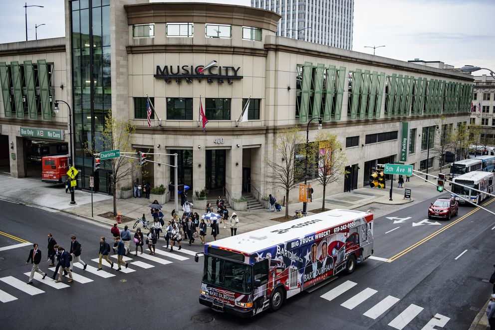 A bus passes Music City Center, the transportation hub in downtown Nashville, Tenn. (William DeShazer/The New York Times)