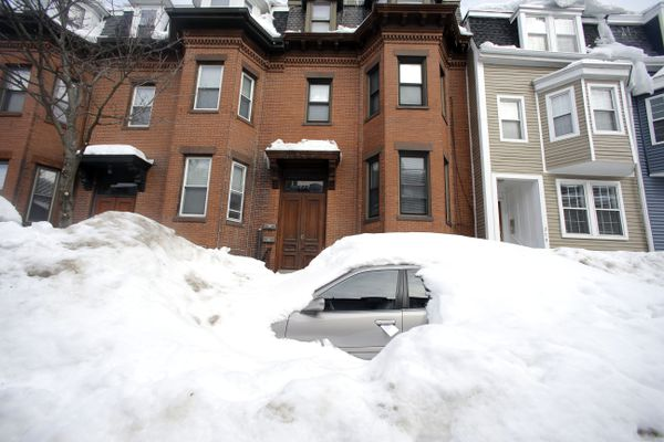 In this Feb. 23, 2015 file photo, a car remains buried in snow along a residential street in South Boston. Boston's miserable winter is now also its snowiest season going back to 1872. The official measurement of 108.6 inches at Logan International Airport Sunday night topped a season record of 107.9 inches set in 1995-96. The final 2.9 inches came in a snowstorm that was relatively tame after a record-setting monthly snowfall of 64.9 inches in February.