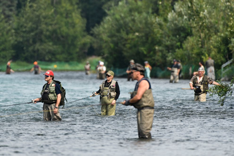 Anglers work along the south side of the Kenai River near its confluence with the Russian River on Thursday, July 18, 2019. (Marc Lester / ADN)