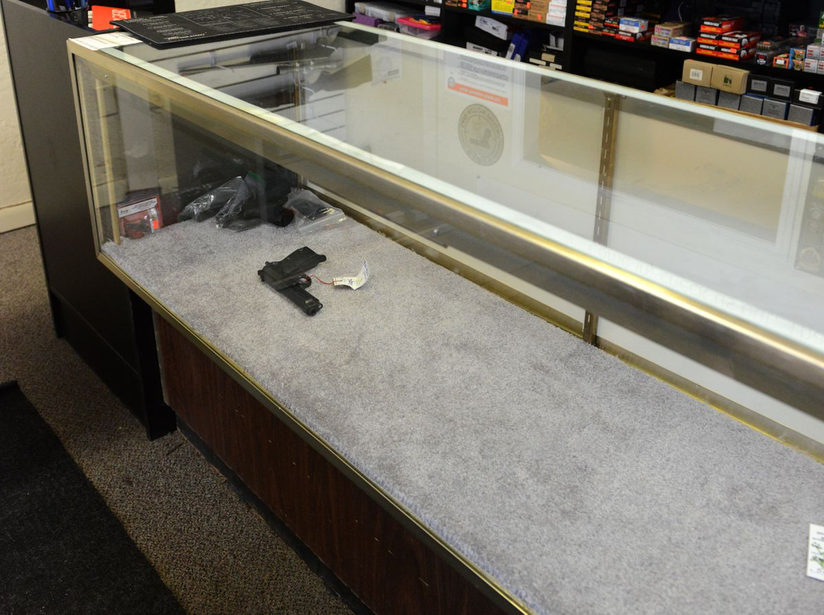 A display case is nearly empty in Anchorage, Alaska on Friday, Sept. 8, 2017 after thieves stole the case full of handguns.  (Bob Hallinen / Alaska Dispatch News)