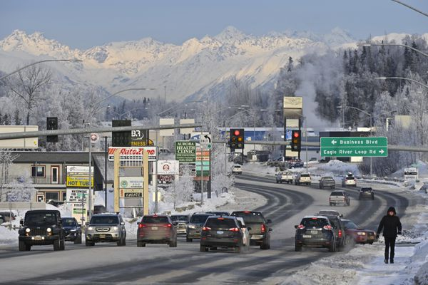 Traffic passes in Eagle River's business district on January 27, 2021. (Marc Lester / ADN)