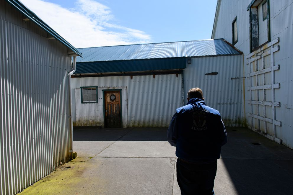 Alitak superintendent Woody Knebel walks outside the cannery buildings on May 15, 2019. (Marc Lester / ADN)