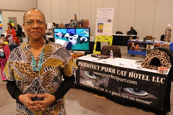 Elaine Parry, owner of the Purrfect Purr Cat Hotel, stands in front of her table at the Alaska Black Business Expo & Summit in the Dena'ina Civic and Convention Center in Anchorage, Alaska, on Saturday, Feb. 4, 2017. The kick off event for Black History Month featured black owned businesses and those that cater to black clientele, a fashion show, performers and a kids dance contest and more. (Bob Hallinen / Alaska Dispatch News)