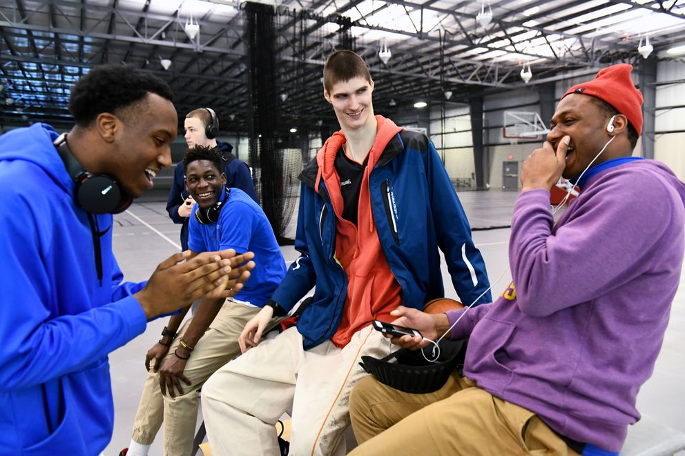 """SPIRE Institute teammates from left DeMar Luther, Yan Kankela, Robert Bobroczky and Isaac Mushirla laugh as they determine who may be """"the next Kobe Bryant."""" Bobroczky, a sophomore at SPIRE Institute, is 7-7 and just under 200 pounds.Washington Post photo by Katherine Frey"""