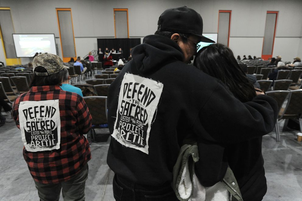 Samuel Johns speaks to his daughter Aaliyah Johns, 11, during the public testimony on the Coastal Plain Oil and Gas Leasing Program DEIS at the Dena'ina Center on Monday, Feb. 11, 2019. (Bill Roth / ADN)