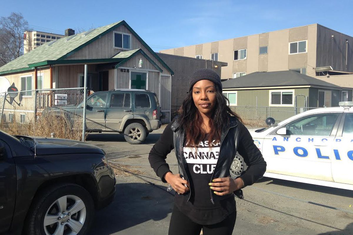 Charlo Greene stands outside the Alaska Cannabis Club headquarters in Anchorage in 2015 as Anchorage police conducted a raid. (Laurel Andrews / Alaska Dispatch News)