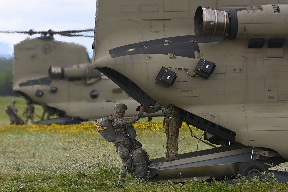 A paratrooper boards a CH-47 Chinook helicopter during airborne operations on Tuesday. (Bill Roth / ADN)