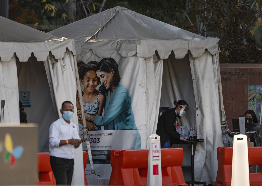 In this Dec. 18, 2020, file photo, medical tents for vaccinations are set outside the Children's Hospital Los Angeles. California became the first state to record 2 million confirmed coronavirus cases, reaching the milestone on Christmas Eve as close to the entire state was under a strict stay-at-home order and hospitals were flooded with the largest crush of cases since the pandemic began. (AP Photo/Damian Dovarganes, File)