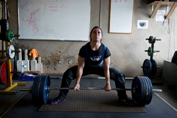 Priscilla Ribic deadlifts 501 pounds during training at Southside Strength and Fitness on July 14, 2017. Ribic, of Anchorage, has won 15 world championships in her hall-of-fame powerlifting career. She currently holds four world records. (Marc Lester / Alaska Dispatch News)