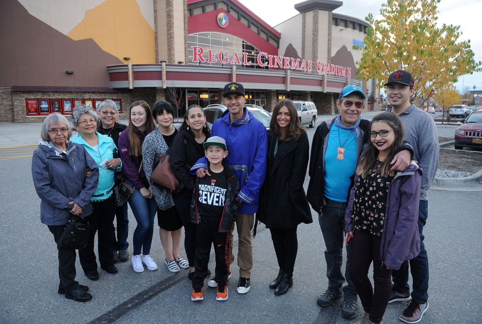 "Martin Sensmeier, his girlfriend Kahara Hodges and family members pose before the opening of ""The Magnificent Seven"" at the Regal Cinemas Stadium 16 at the Tikahtnu Commons in Anchorage on Friday. (Bob Hallinen / Alaska Dispatch News)"