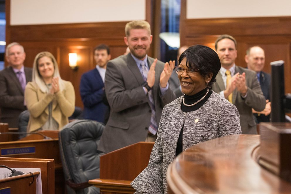 Rep. Sharon Jackson, R-Eagle River, is applauded by her colleagues after she took the oath of office from House Speaker Pro Tempore Rep. Neal Foster on Thursday. (Loren Holmes / ADN)