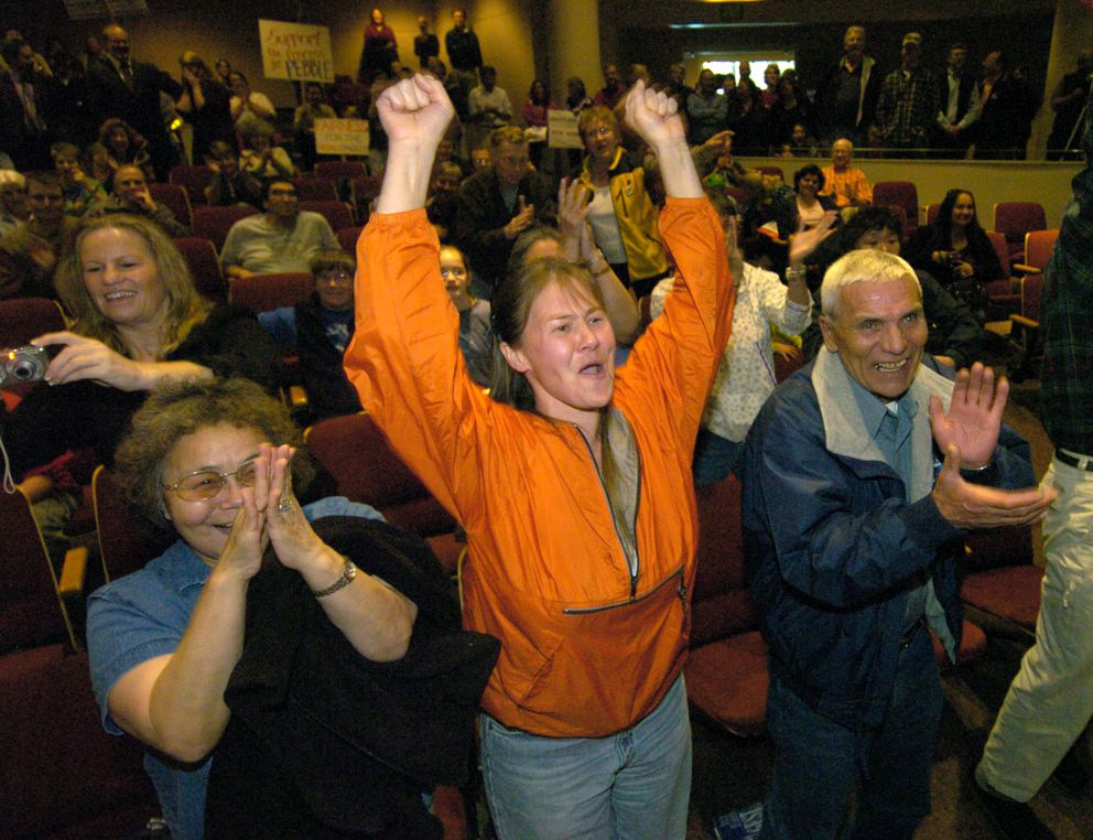 Esther Togiak, Audrey Roberts, and Hjalmer Olson celebrated after Bryce Edgmon won the coin flip. (Bill Roth / ADN archive 2006)
